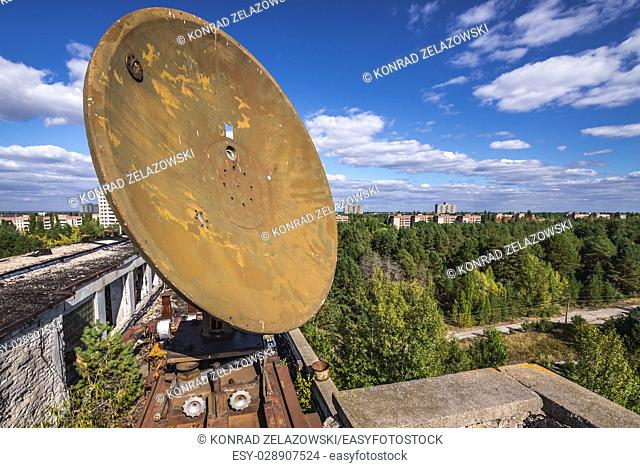 Satellite dish on the roof of abandoned Jupiter Factory in Pripyat ghost town of Chernobyl Nuclear Power Plant Zone of Alienation in Ukraine