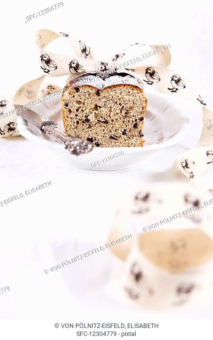 Easter bread with currants and pecans, decorated with ribbon