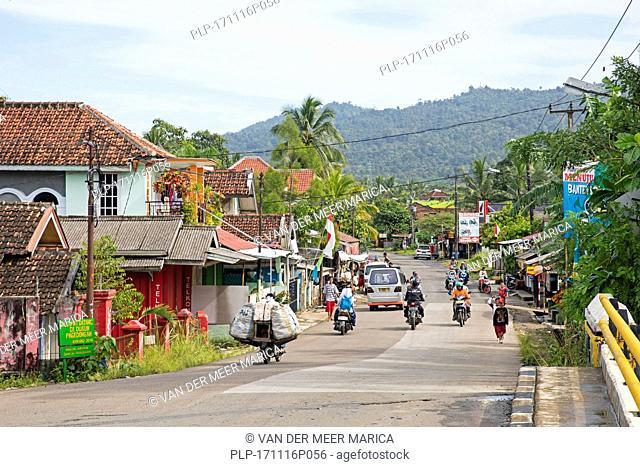 Street scene showing motorbikes in the coastal town Carita, Pandeglang Regency, Banten Province, West Java, Indonesia