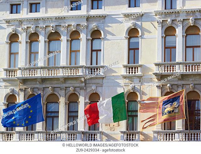 Flags of the European union, Italy and the Venetian flag flying on the Palazzo Ferro Fini, Venice, Veneto, Italy, Europe