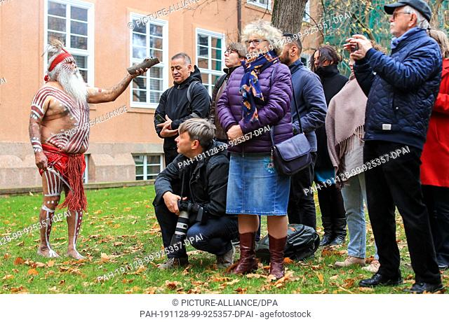 dpatop - 28 November 2019, Saxony, Leipzig: Major Sumner, representative of the Australian Ngarrindejeri Community, conducts a smoking ceremony in the courtyard...