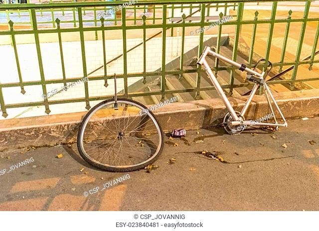 Abandoned wreck of bike in city streets