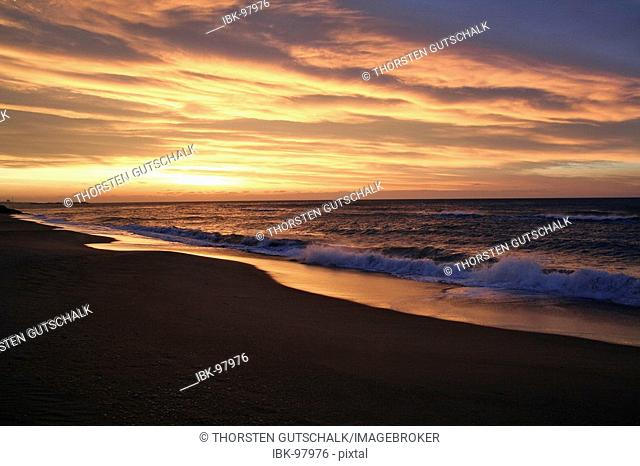 Deserted lonely beach in the early season El Vendrell, Coma Ruga Costa Dorada Spain, Sunset on the sea