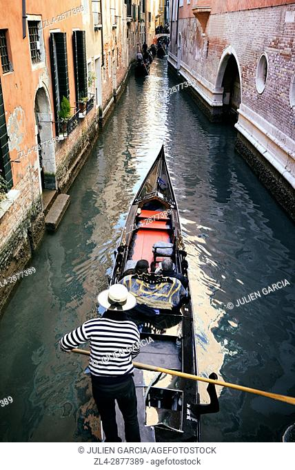 Italy, Veneto, Venice, listed as World Heritage by UNESCO, gondola ride on canals, gondolier with hat