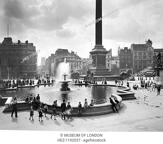 Trafalgar Square, City of Westminster, London, c1930. Reid, an amateur photographer of independent means, began an ambitious project to record