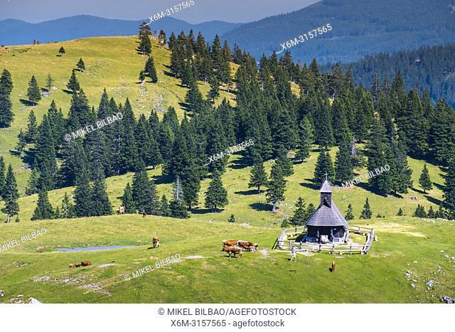 Mountains in summer and church. Velika Planina area. Upper Carniola region. Slovenia, Europe