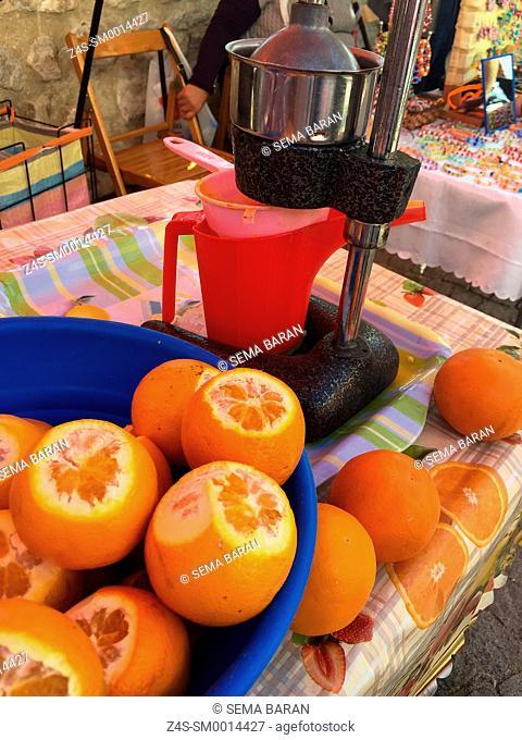 Fresh oranges ready to squeeze in the street market of the Sigacik town, Seferihisar, Izmir, Aegean Coast, Turkey, Europe