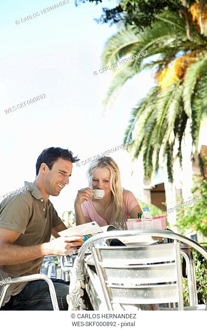 Spain, Mallorca, Palma, Couple sitting at table in cafe