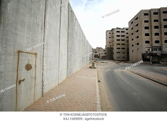 Someone has drawn a door on the wall Israel is building around the west bank territories, blocking access for Palestinians who feel imprisoned by it
