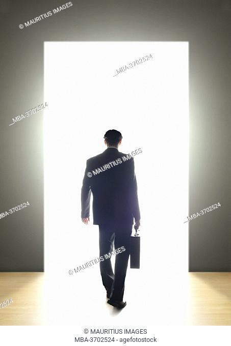 Businessman, door, light