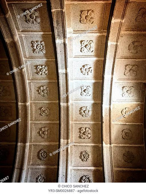 Flowers carved in the roof of the Church Con-cathedral of Santa María ( Concatedral de Santa Maria ) of Caceres, Extremadura, Spain