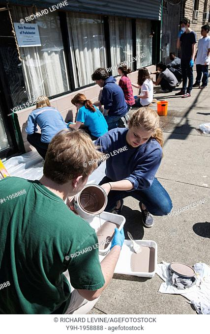 Volunteer teens from the predominantly Catholic Manhattan College, the Islamic Leadership School and Cong. Tehillah of Riverdale paint and clean the space of...