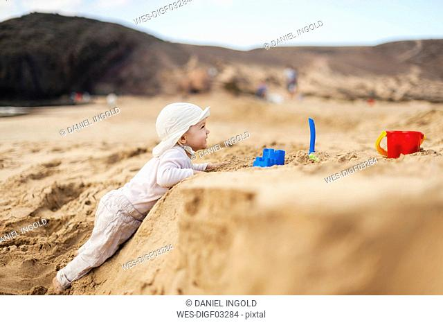 Spain, Lanzarote, baby girl playing on the beach