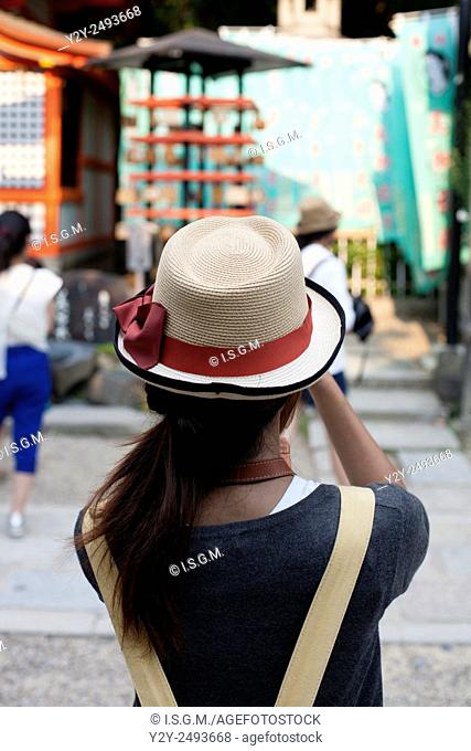 Asiatic girl with hat