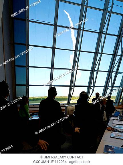 NASA management watch the launch of space shuttle Discovery (STS-133) from the firing room at Kennedy Space Center, Thursday, Feb
