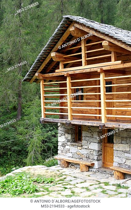 A restored alpine home made of local stone and wood, while the roof is covered by slate flat stones. Valsesia. Pennine Alps. Piedmont. Italy