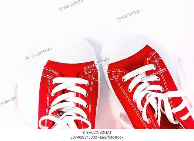 Pair of red shoes on white background