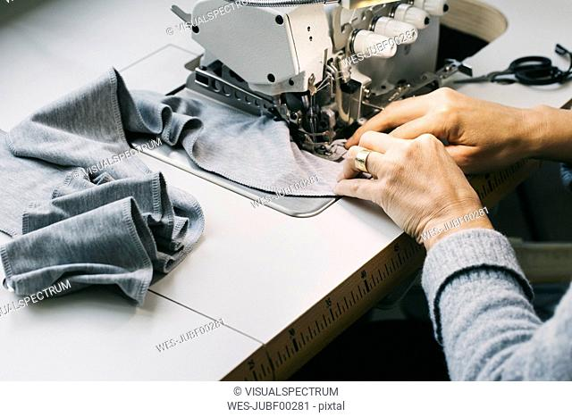 Close-up of woman using sewing machine