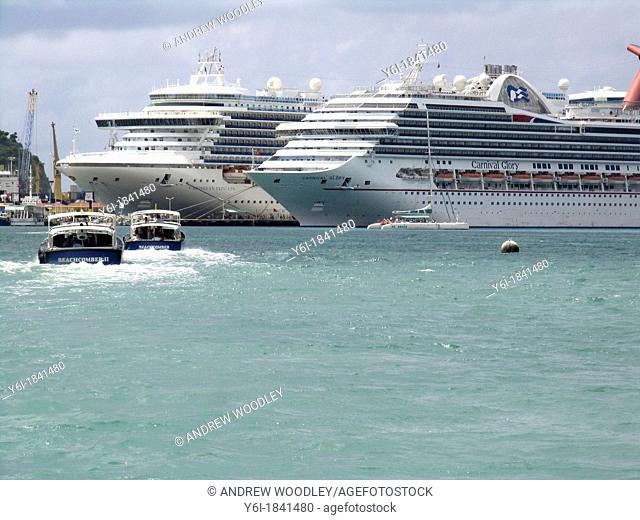 Water taxis return cruise ship visitors to Caribbean Princess left and Carnival Glory docked at Philipsburg St Maarten