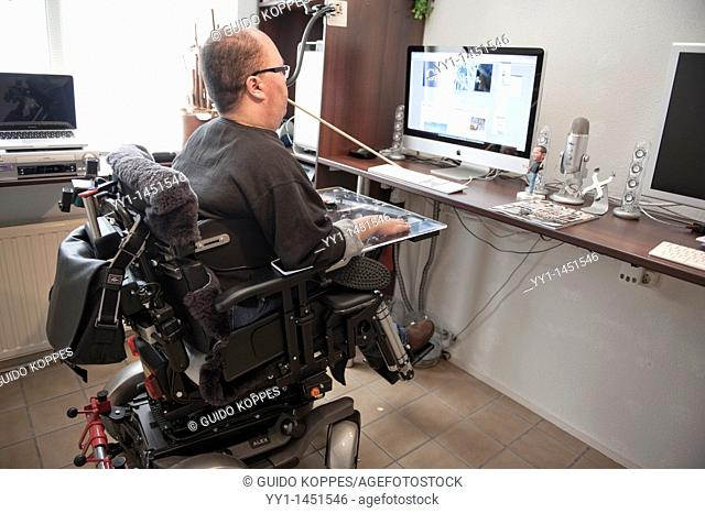 Handicapped man working from home on his computer