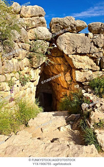 Entrance to Mycenae water cisterns for underground water storage  Excavated by the archaeologist Heinrich Schliemann in 1876  Mycenae UNESCO World Heritage...