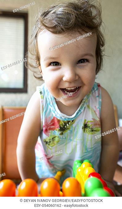 Smiling little girl. Blocks toy