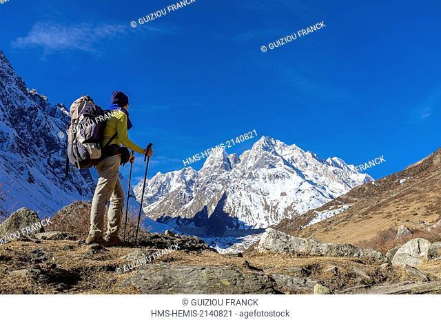 Nepal, Gandaki zone, Manaslu Circuit, between Samdo and Dharamsala, climbing to Dharamsala, Larkya Peak (alt.6249m) in the background