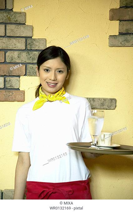 Waitress carrying drinks on tray