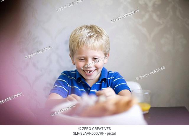 Boy smiling at dinner table