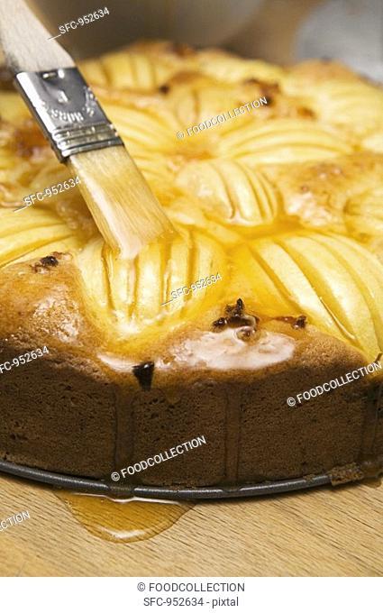 Brushing apple cake with egg yolk