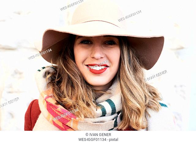 Portrait of a smiling stylish woman wearing a floppy hat