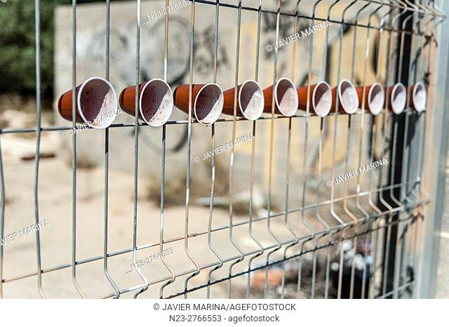 Fence with plastic cups, Valencia, Spain