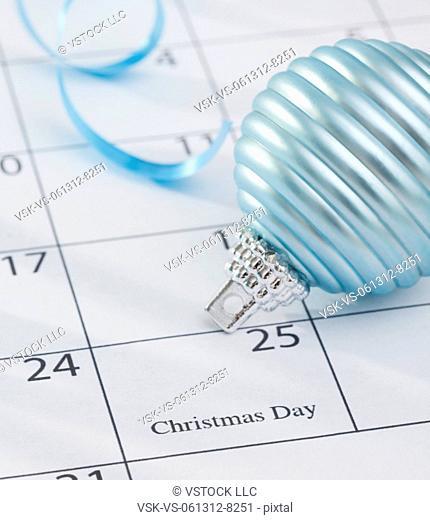 USA, Illinois, Metamora, Christmas bulb laying on calendar