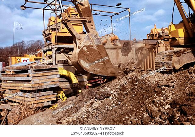 Backhoe dig trench Stock Photos and Images | age fotostock