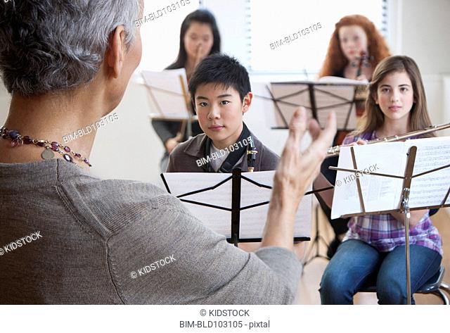Teacher and students in music class
