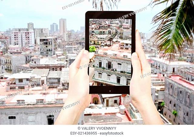 tourist taking photo of houses in old Havana city