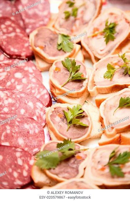 Sausage and sandwiches with meat on plate