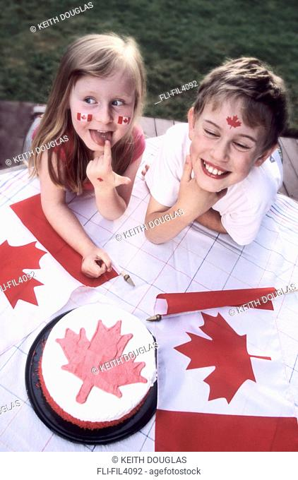 Young Boy and Girl celebrating on Canada Day, Smithers, British Columbia