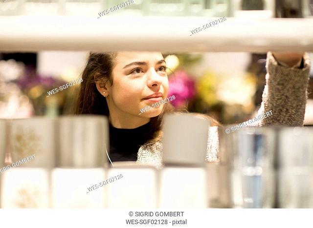 Portrait of young woman in a shop