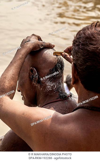 Barber Shaving Head Ganga River Varanasi Ghat Uttar Pradesh India Asia
