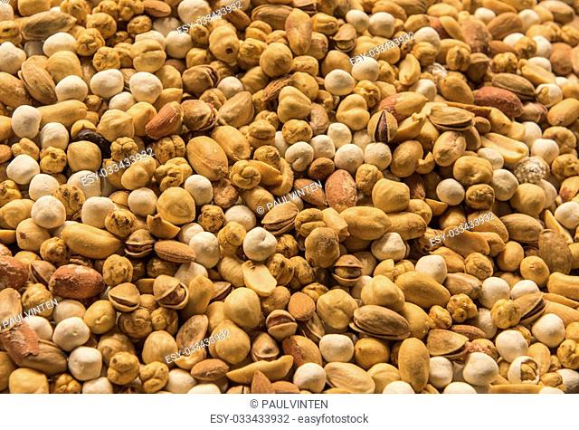 Variety selection of nuts on display at a bazaar market stall