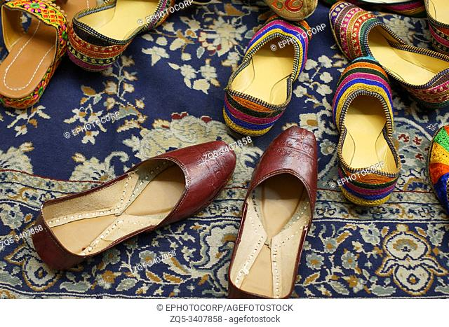Traditional footwear made by local artisans for sale at Jodhpur in Rajasthan, India