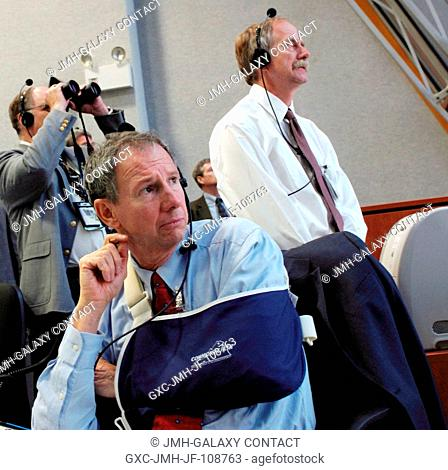 NASA Administrator Michael Griffin (foreground) watches the launch of the Space Shuttle Endeavour, to get STS-118 underway