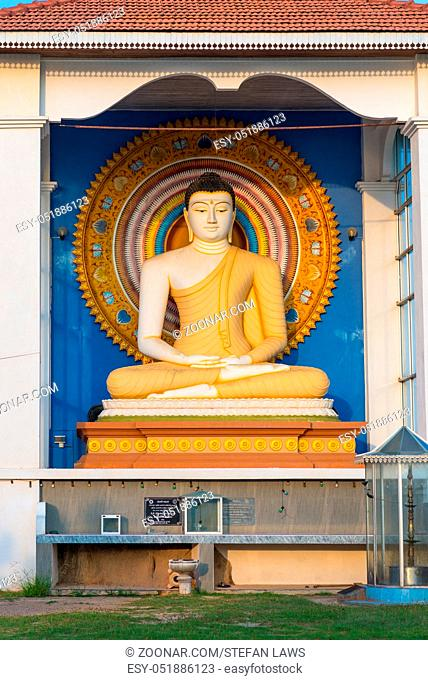 The Buddhist monastery and temple Wella Devalaya in Unawatuna. On the top of the hill, a large Buddha in lotus position. Devol is one of the twelve deities...