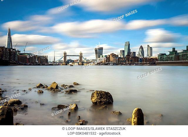 City of London across the Thames at low tide