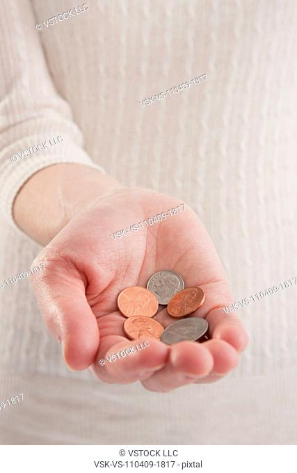 USA, Illinois, Metamora, close-up of woman's hand holding pennies
