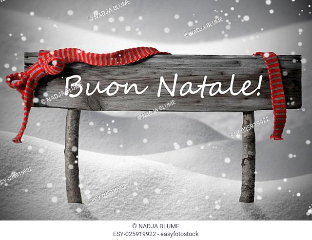 Gray Wooden Christmas Sign On White Snow. Snowy Scenery, Snowflakes. Red Ribbon, Italian Text Buon Natale Means Merry Christmas. Christmas Card