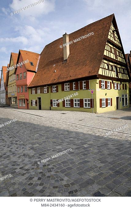 Gingerbread style commercial and residential apartment buildings in the medieval town of Dinkelsbuhl in late summer, Germany