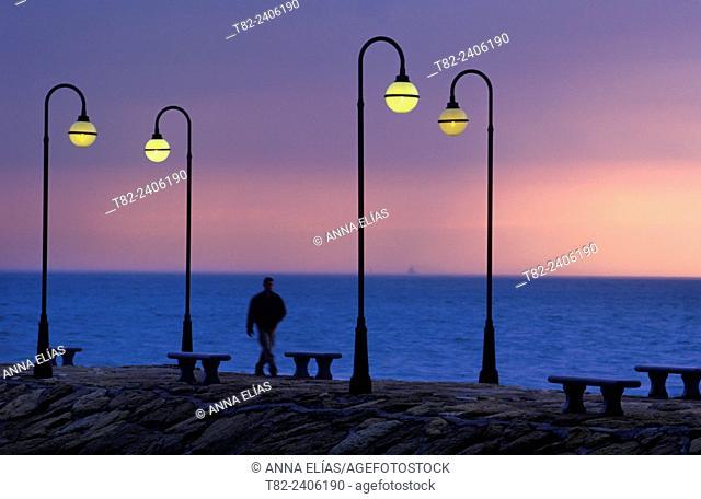 man and illuminated promenade, Andalucia, Spain, Europe