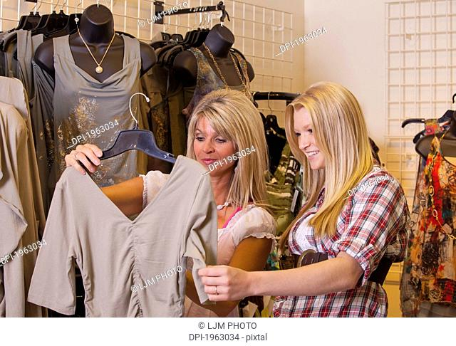 mother and daughter shopping for clothing at a boutique, edmonton, alberta, canada
